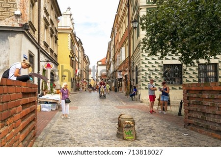 Warsaw, Poland - August 2, 2017: Architecture and people on the street New World in Warsaw #713818027