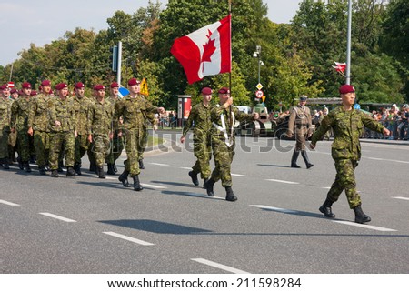WARSAW, POLAND - AUGUST 15, 2014: Canadian Armed Forces during the parade. Polish Armed Forces Day. Over 1200 Polish and over 90 foreign soldiers, over 120 military vehicles, more than 50 aircraft