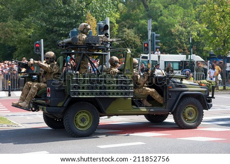 WARSAW, POLAND - AUGUST 15, 2014: GROM Special forces in Mercedes-Benz G class, Polish Armed Forces Day. Over 1200 Polish and over 90 foreign soldiers, over 120 military vehicles, over 50 air craft