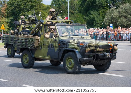 WARSAW, POLAND - AUGUST 15, 2014: GROM Special forces in Mercedes G car. Polish Armed Forces Day. 1200 Polish and 90 foreign soldiers,120 military vehicles,over 50 air craft
