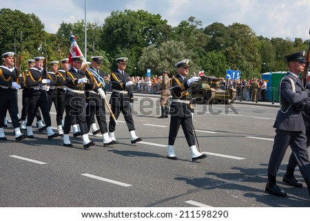 WARSAW, POLAND - AUGUST 15, 2014: Polish Navy forces at the Polish Armed Forces Day. Over 1200 Polish and over 90 foreign soldiers. Over 120 military vehicles, more than 50 aircraft