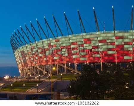 WARSAW, POLAND - CIRCA MAY 2012 - National stadium at night, Warsaw, Poland. The stadium is the host for UEFA football Euro cup circa May 2012. - stock photo