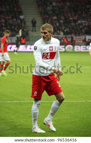 WARSAW, POLAND - FEBRUARY 29: Damien Perquis (Poland, FC Sochaux) during the friendly football match between Poland vs Portugal on February 29, 2012 in Warsaw, Poland. Final results: 0:0