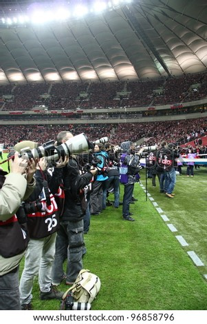 WARSAW, POLAND - FEBRUARY 29: Professional sports photographers during the friendly football match between Poland vs Portugal on February 29, 2012 in Warsaw, Poland. Final results: 0:0