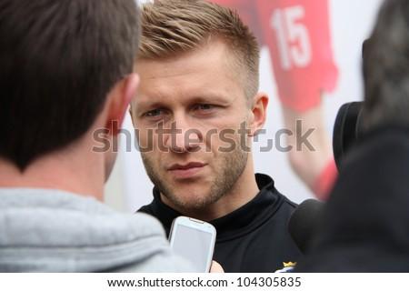 WARSAW, POLAND - JUNE 3: Kuba Blaszczykowski (Borussia Dortmund), Poland national football team captain is interviewed after training, on June 3, 2012 in Warsaw, Poland.