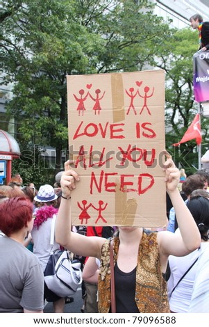 WARSAW, POLAND - JUNE 11: Love is all you need. An unidentified girl taking part in Pride Parade 2011 to support gay rights, on June 11, 2011 in Warsaw, Poland.