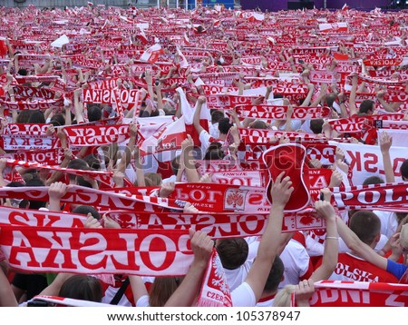 WARSAW, POLAND - JUNE 16: Thousands of Polish fans gathered in Fanzone, to support national team minutes before UEFA EURO 2012 football match vs. Czech team, June 16, 2012 in Warsaw, Poland