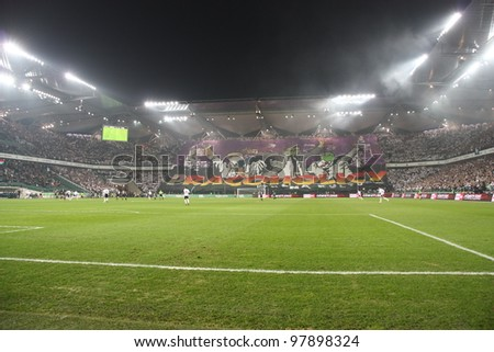 WARSAW, POLAND - MARCH 16: Pepsi Arena stadium during the Warsaw's football derby between Legia Warsaw vs Polonia Warsaw on March 16, 2012 in Warsaw, Poland. Legia supporters extend a big banner. - stock photo