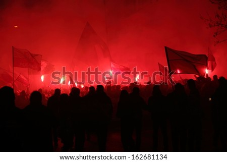 WARSAW, POLAND - NOVEMBER 11: The riots in the streets of Warsaw during the celebration of Independence Day on November 11, 2013 in Warsaw, Poland.