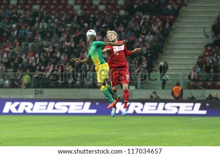 WARSAW, POLAND - OCTOBER 12: Bernard Parker (17) and Damien Perquis (24) fight for a ball during friendly soccer game between Poland and RSA on the National Stadium in Warsaw on October 12, 2012
