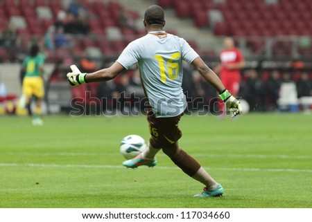 WARSAW, POLAND - OCTOBER 12: Itumeleng Khune (16) kicks the ball during friendly soccer game between Poland and RSA on the National Stadium in Warsaw on October 12, 2012