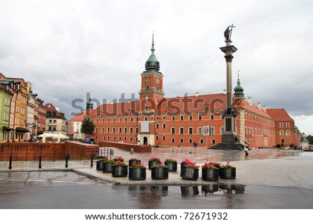Warsaw, Poland. Old Town - famous Royal Castle at Plac Zamkowy square. UNESCO World Heritage Site. Rainy weather.