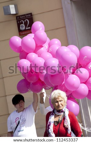 WARSAW, POLAND, SEPT 8: Balloons and woman on XV Pink Ribbon Walk against the Breast Cancer september 8, 2012 in Warsaw, Poland.