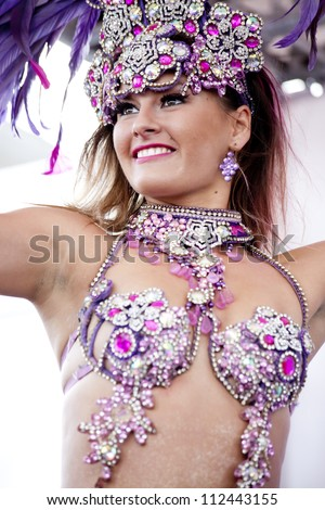 WARSAW, POLAND, SEPT 8: Unidentified Carnival dancers on the XV Pink Ribbon Walk against the Breast Cancer september 8, 2012 in Warsaw, Poland. - stock photo