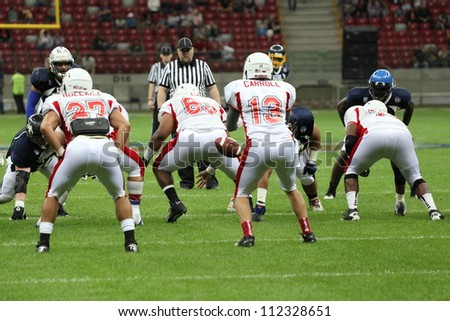WARSAW, POLAND - SEPTEMBER 1: American football player, Europe team member Isaac Williams passes a football to Wes Carroll during Euro-American Challenge match on September 1, 2012 in Warsaw, Poland.