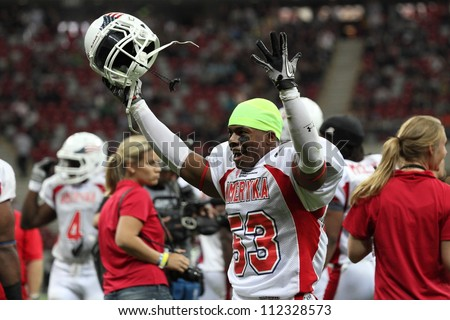 WARSAW, POLAND - SEPTEMBER 1: American football player, US team member Kesnel Menard (LB) screams to other team members during Euro-American Challenge match on September 1, 2012 in Warsaw, Poland.