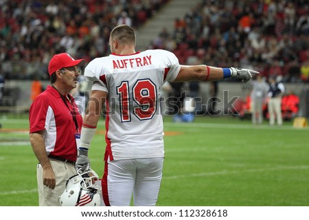WARSAW, POLAND - SEPTEMBER 1: American football player, US team member Kyle Auffray (TE) talks to the team couch during Euro-American Challenge match on September 1, 2012 in Warsaw, Poland.