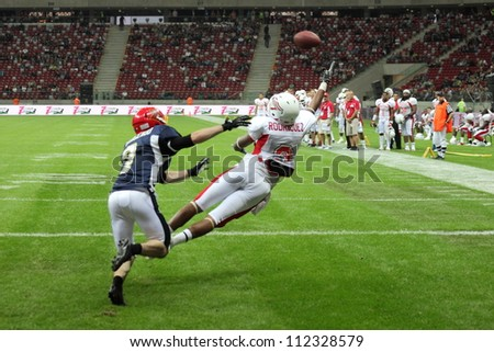 WARSAW, POLAND - SEPTEMBER 1: American football player, US team member Michael Rodriquez (TE/WR) tries to catch a football during Euro-American Challenge match on September 1, 2012 in Warsaw, Poland.