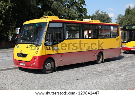 WARSAW, POLAND - SEPTEMBER 8: People ride Mercedes bus on September 8, 2010 in Warsaw, Poland. Mercedes Buses recently celebrated 100th anniversary of cooperation with Daimler Engines.