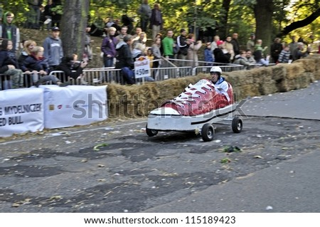 WARSAW, POLAND - SEPTEMBER 23: Unidentified competitor rides his homemade vehicle during the Red Bull Soapbox Race on September 23, 2012 in Warsaw, Poland.