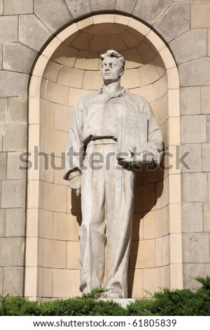 Warsaw, Poland. Statue in Palace of Culture and Science facade - famous sculpture holding book with names: Marx, Engels, Lenin. There was also Stalin, but it was removed (remains visible).