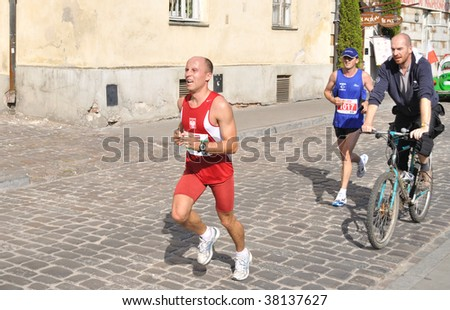 WARSAW - SEPTEMBER 27: Runners participate in the 31st Warsaw Marathon September 27, 2009 in Warsaw, Poland. More than 3000 participants took part in this Marathon.