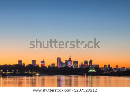 Warsaw skyline at night reflected in water #1207529212