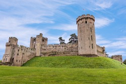 Warwick Castle s a medieval castle  original built by William the Conqueror in 1068. Warwick is the county town of Warwickshire, England, situated on a bend of the River Avon.