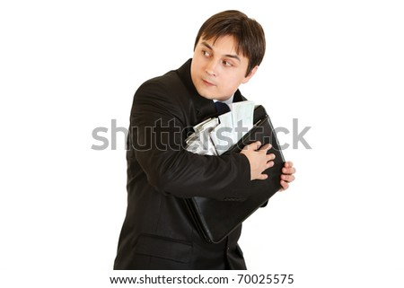 Wary businessman hugging briefcase with money in hands isolated on white