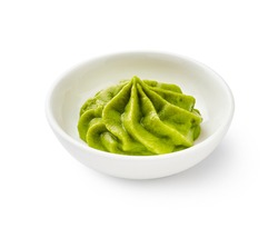 Wasabi in bowl isolated on white background