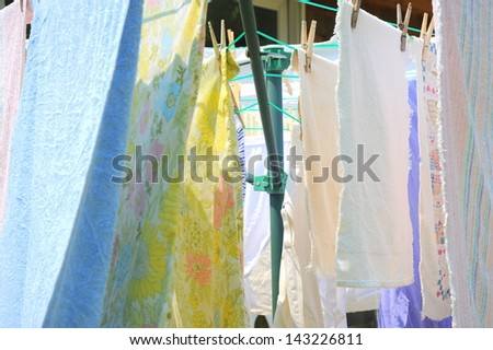 Wash day with towels hanging on the line to dry.