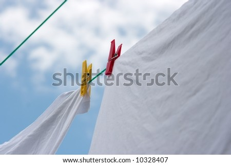 Washed clothes drying on a rope in the garden