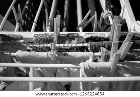 Washed clothes on a drying rack #1263224854