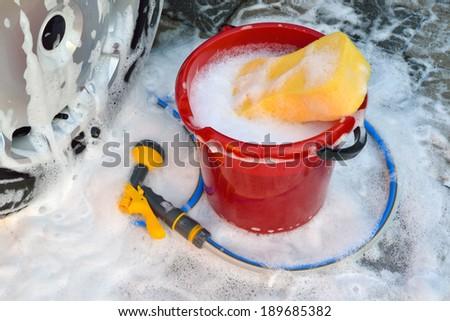 washing a car by hand #189685382