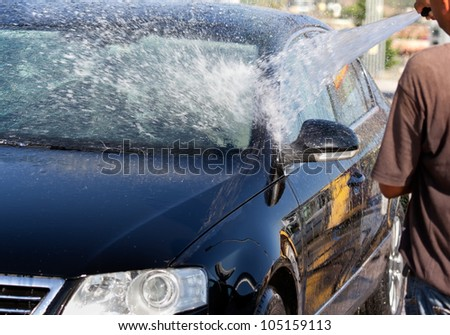 Washing a car with water