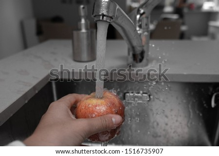 Washing a freshly picked apple