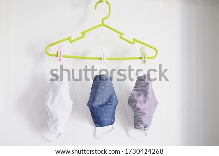 Washing and drying the fabric mask to prevent dust and corona virus. Drying sanitary face masks in the shade.Reuse fabric face mask. concept.Fashion and health care of new normal lifestyle.