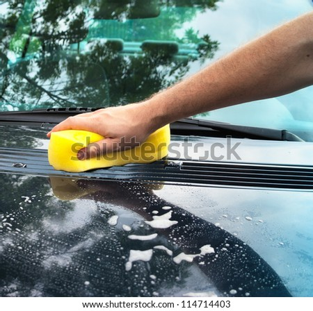 washing car with a sponge