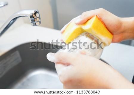 Washing dishes image