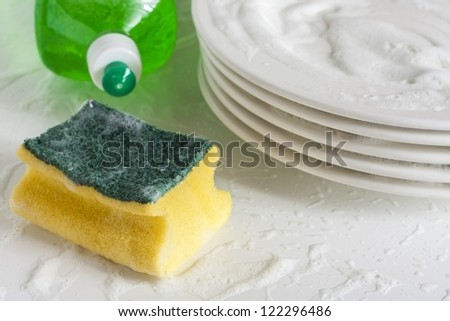 Washing glasses and plates with detergent and water