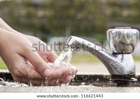 Washing Hands at outdoor      faucet