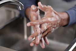 Washing hands with soap and water at the faucet, Hygiene concept