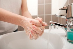 Washing hands with soap under the faucet with water for corona virus prevention, hygiene to stop spreading coronavirus. Hygiene concept, Hygiene sanitary, clean, wash, disinfect hygienic human.
