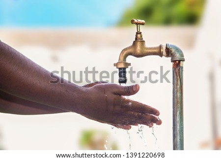 Washing hands with tap water