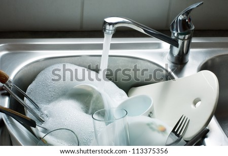 Washing kitchen ware on the sink