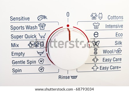 Washing machine control plate and dial