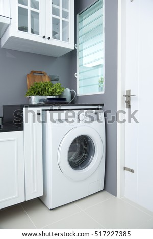 washing machine in a kitchen room #517227385