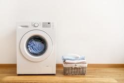 Washing machine, washing gel and laundry basket on white background