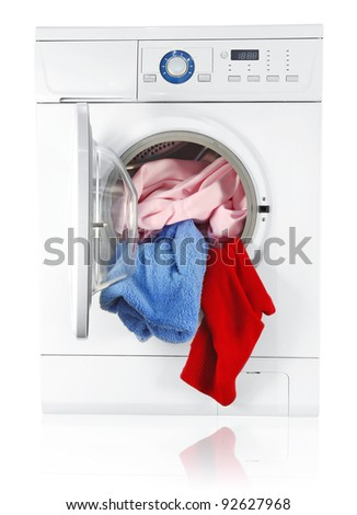 washing machine with linen isolated on white background