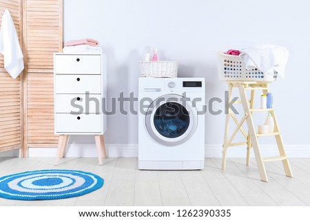 Washing machine with towels in laundry room interior #1262390335